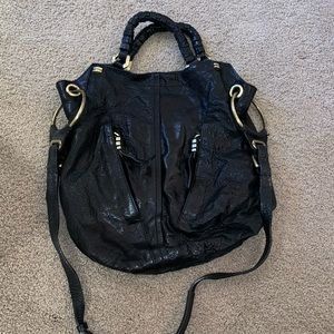 Beautiful black leather distressed handbag